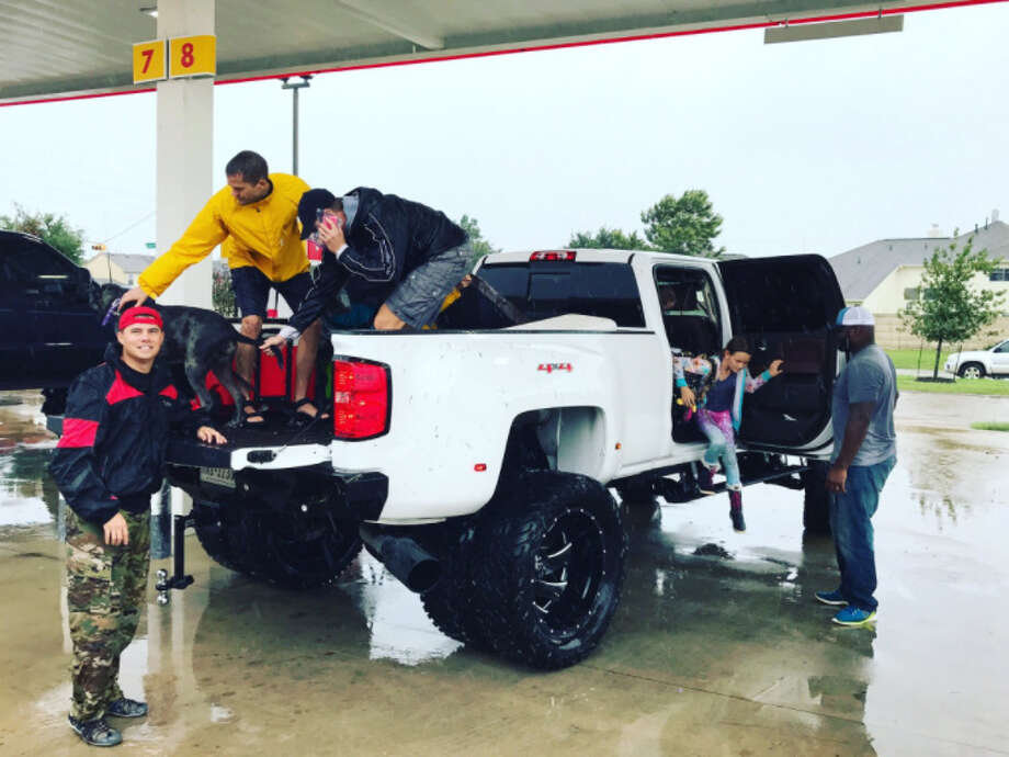 PHOTOS: Derrick Lewis in action in the UFCUFC fighter Derrick Lewis (far right) rescued a family who was walking in high water in Cypress on Monday.Browse through the photos above for a look at Derrick Lewis in the Octagon. Photo: Derrick Lewis