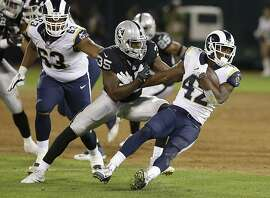 Los Angeles Rams running back Justin Davis (42) runs from Oakland Raiders linebacker Nicholas Morrow (35) during the second half of an NFL preseason football game in Oakland, Calif., Saturday, Aug. 19, 2017. (AP Photo/Rich Pedroncelli)