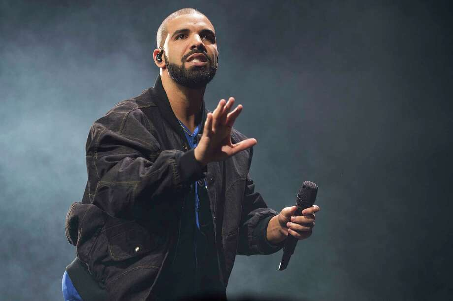 FILE - In this Oct. 8, 2016 file photo, Drake performs onstage in Toronto. Drake leads the nominations for the 2017 iHeartRadio Music Awards with 12, including male artist of the year, announced Wednesday, Jan. 4, 2017. (Photo by Arthur Mola/Invision/AP, File) Photo: Arthur Mola, INVL / Invision