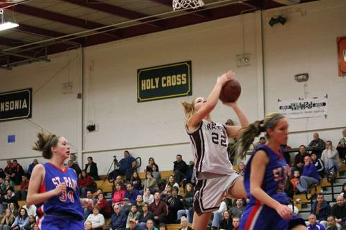 Torrington's Aly Otis drives to the basket during third quarter action in the Raiders 56-36 win over St Paul on Tuesday night in Torrington. (Timothy Gaffney/Register Citizen)