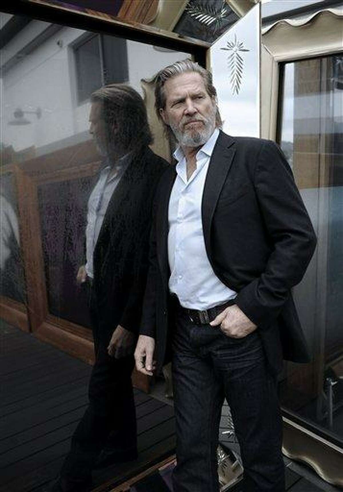 FILE - In this Nov. 19, 2010 file photo, actor Jeff Bridges poses for a portrait during the press junket for the feature film