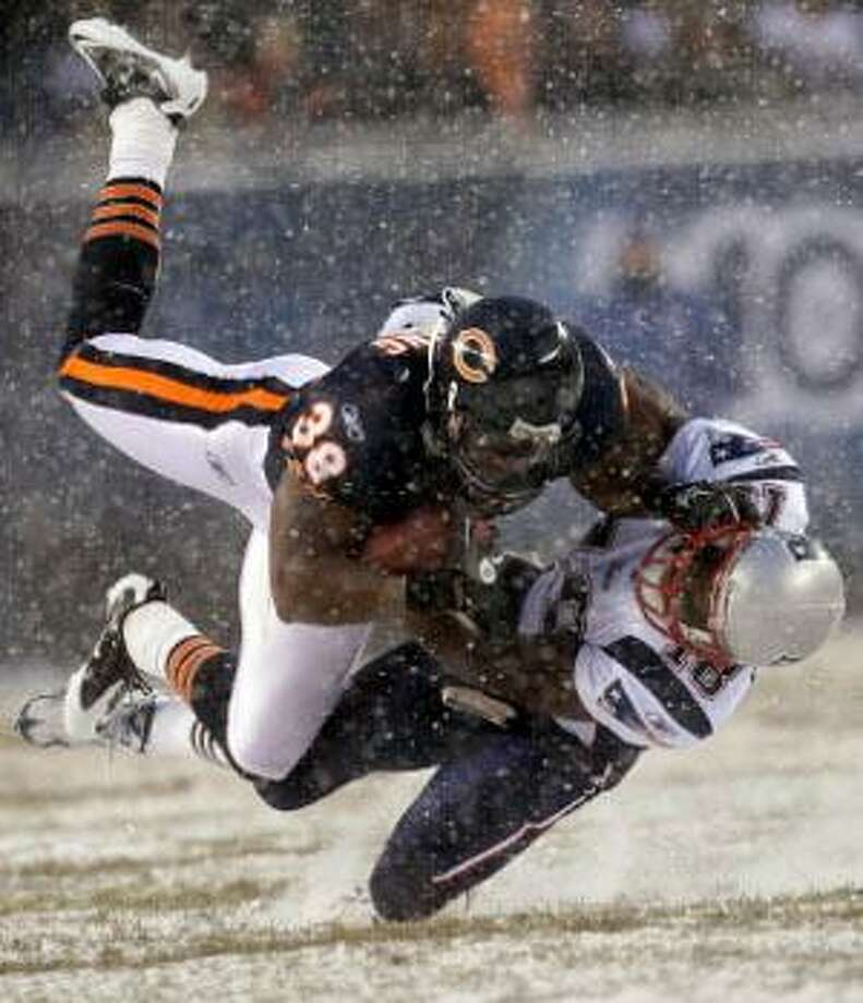 AP Chicago Bears safety Danieal Manning (38) is tackled by New England Patriots' Matt Slater (18) on a kickoff return in the first half of Sunday's game in Chicago. The Patriots won 36-7.