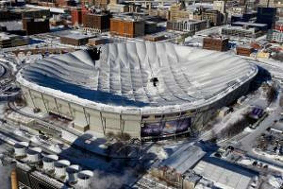 AP Holes in the collapsed Metrodome roof can be seen in Minneapolis Sunday. The inflatable roof of the Metrodome collapsed Sunday after a snowstorm that dumped 17 inches on Minneapolis. No one was hurt, but the roof failure sent the NFL scrambling to find a new venue for the Vikings' game against the New York Giants. The teams will face off tonight at Ford Field in Detroit.
