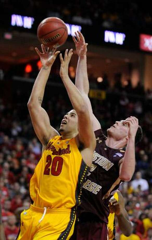 Maryland's Jordan Williams, left, shoots and is fouled by Boston College's Joe Trapani in the second half of a game, Sunday, in College Park, Md. Boston College won 79-75. (AP Photo/Gail Burton)