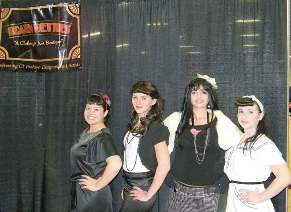 MIKE AGOGLIATI/ Register Citizen Julia Sloan, left, stands with the winners of the Betty Page look-a-like contest which was held during the Brazen Betties Vintage Expo on Saturday. From left are Sloan, Carlena McCord, Angela Colucci and Jennifer McKeeman.