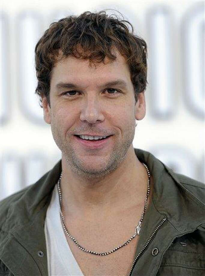 Dane Cook arrives at the MTV Video Music Awards in Los Angeles.  The Massachusetts attorney general's office has ordered comedian Dane Cook's half brother and sister-in-law to pay $12 million in restitution after they pleaded guilty to stealing from him. Photo: AP / AP2010