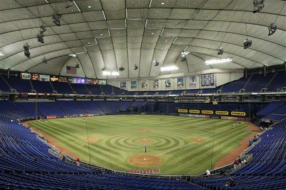 In this Sept. 16, 2009 file photo, the Metrodome is shown in Minneapolis. The Metrodome collapsed during a snowstorm Sunday morning Dec. 12, 2010. Minneapolis and much of the upper Midwest have been hit by a blizzard that has dumped up to 20 inches of snow in some areas. (AP Photo/Ann Heisenfelt, File)