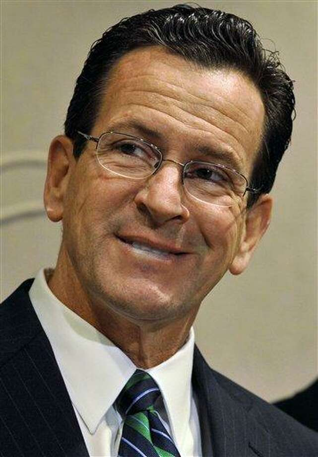 FILE - In this Nov. 17, 2010 file photo, Connecticut Gov.-elect Dan Malloy  smiles at a news conference at the Legislative Office Building in Hartford, Conn. For the first time in 16 years, a totally new administration is being crafted at the state capitol. Even before he won the Democratic primary, Dan Malloy was planning for his possible transition as Connecticut's next governor.  (AP Photo/Jessica Hill, File) Photo: AP / AP2010