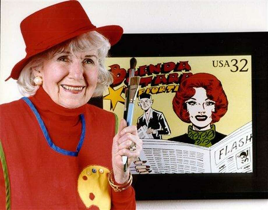 "FILE - In this February 1998 file photo, Dale Messick, creator of the redheaded comic heroine ""Brenda Starr,"" poses for a photograph at her home in Oakmont, Calif.  Messick, whose strip ran in 250 newspapers at its peak in the 1950s, died in April 2005. Tribune Media Services, which owns Brenda Starr, said Thursday, Dec. 9, 2010, it will end the feature's newspaper syndication.  Chicago Tribune columnist Mary Schmich and artist June Brigman said they've decided it was time to end their work on the seven-day-a-week strip which now appears in about three dozen newspapers. The final episode of the soap opera cartoon will be published Jan. 2. (AP Photo/Michael Amsler, File) Photo: AP / AP2005"