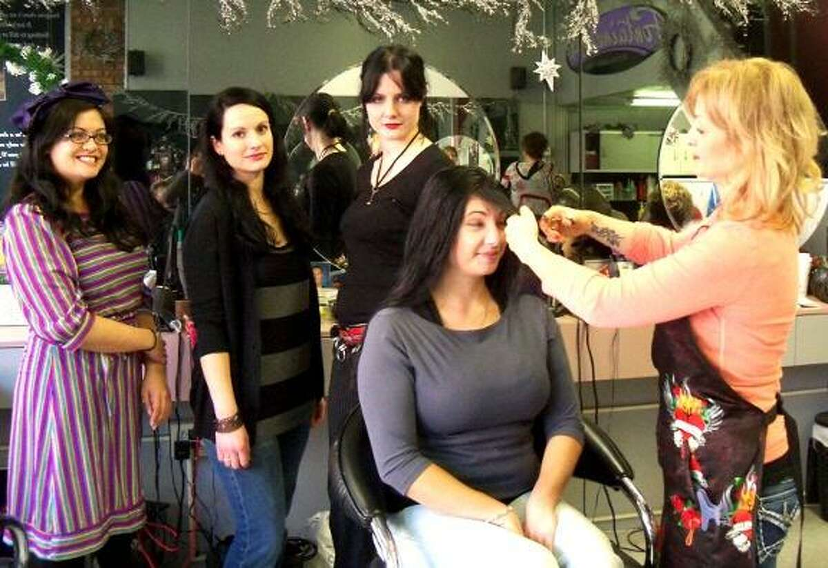 PHOTOS BY JENNY GOLFIN The staff of Brazen Betties in Torrington line up to have their bangs trimmed for the Bettie Page lookalike contest at their upcoming expo at the Torrington Armory.