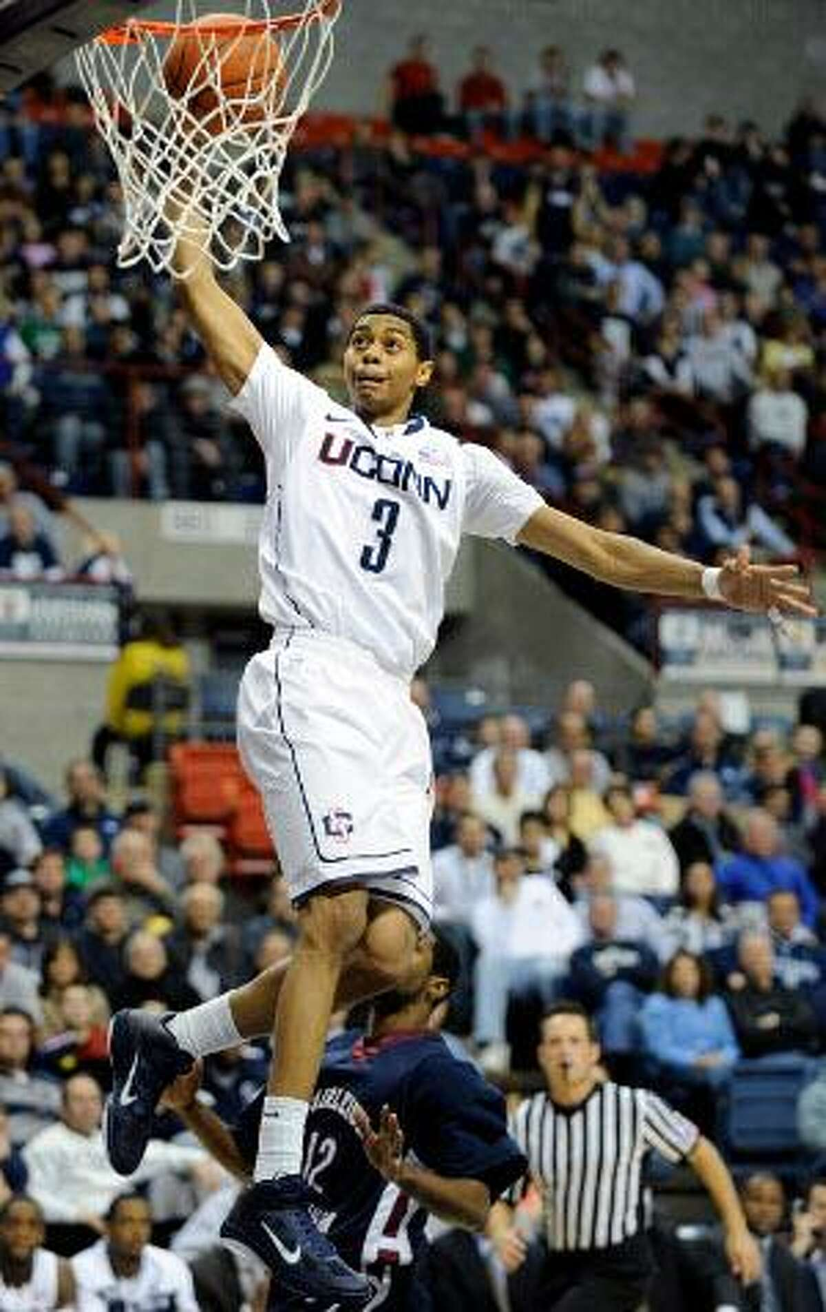 AP Connecticut's Jeremy Lamb scores during the second half of Connecticut's 78-54 victory over Fairleigh Dickenson Wednesday in Storrs.
