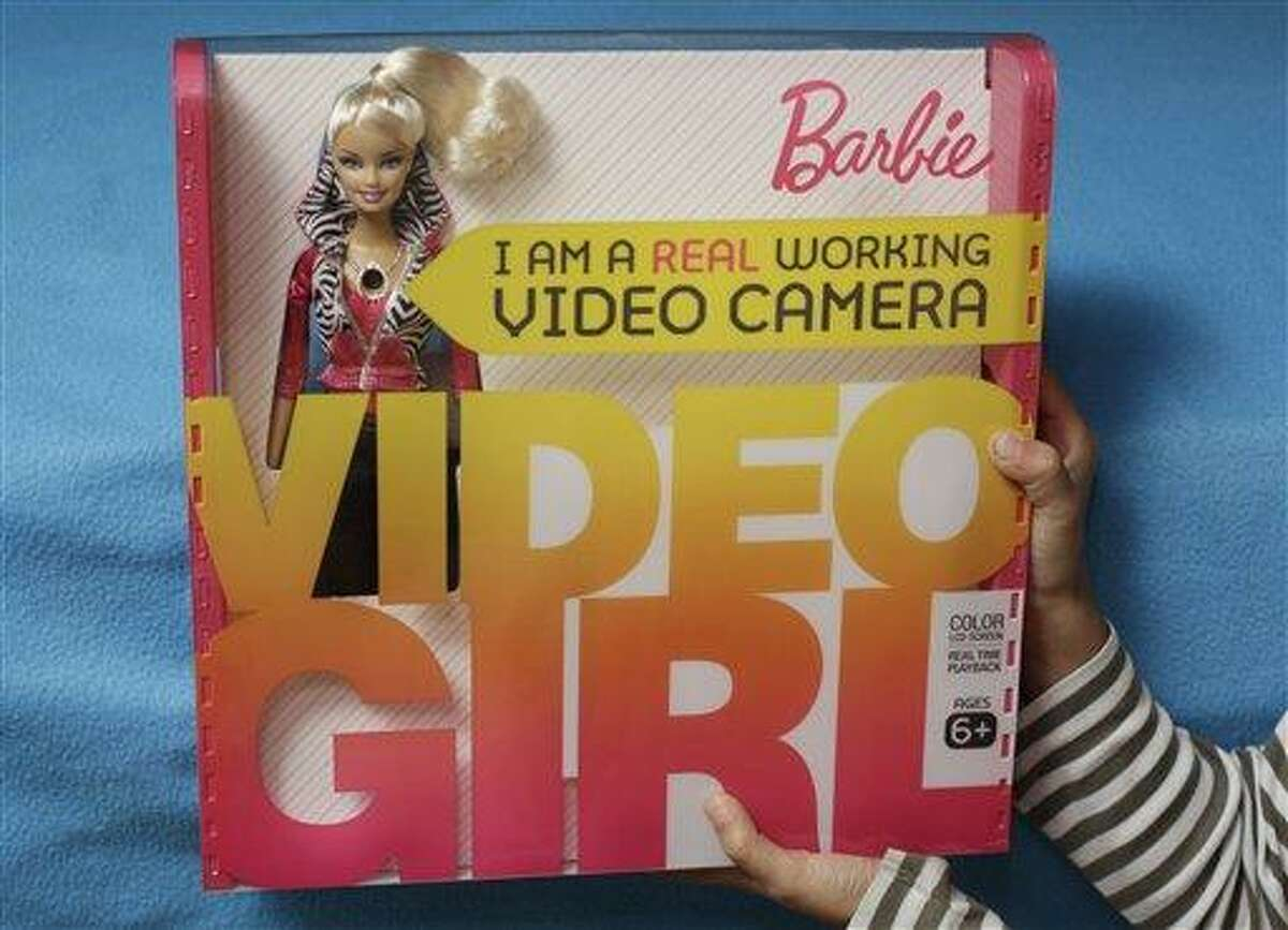 """A Video Barbie doll is shown in Palo Alto, Calif., Tuesday, Dec. 7, 2010. The FBI says it recently issued an alert about a popular Barbie doll with a hidden video camera that could be used to produce child pornography, but stressed that the toy has not been linked with any reported crimes. The said FBI Tuesday the alert last month was meant only for law enforcement agencies to advise them not to overlook Mattel's """"Barbie Video Girl"""" during any searches. The alert was sent out by the bureau's Sacramento office. (AP Photo/Paul Sakuma)"""