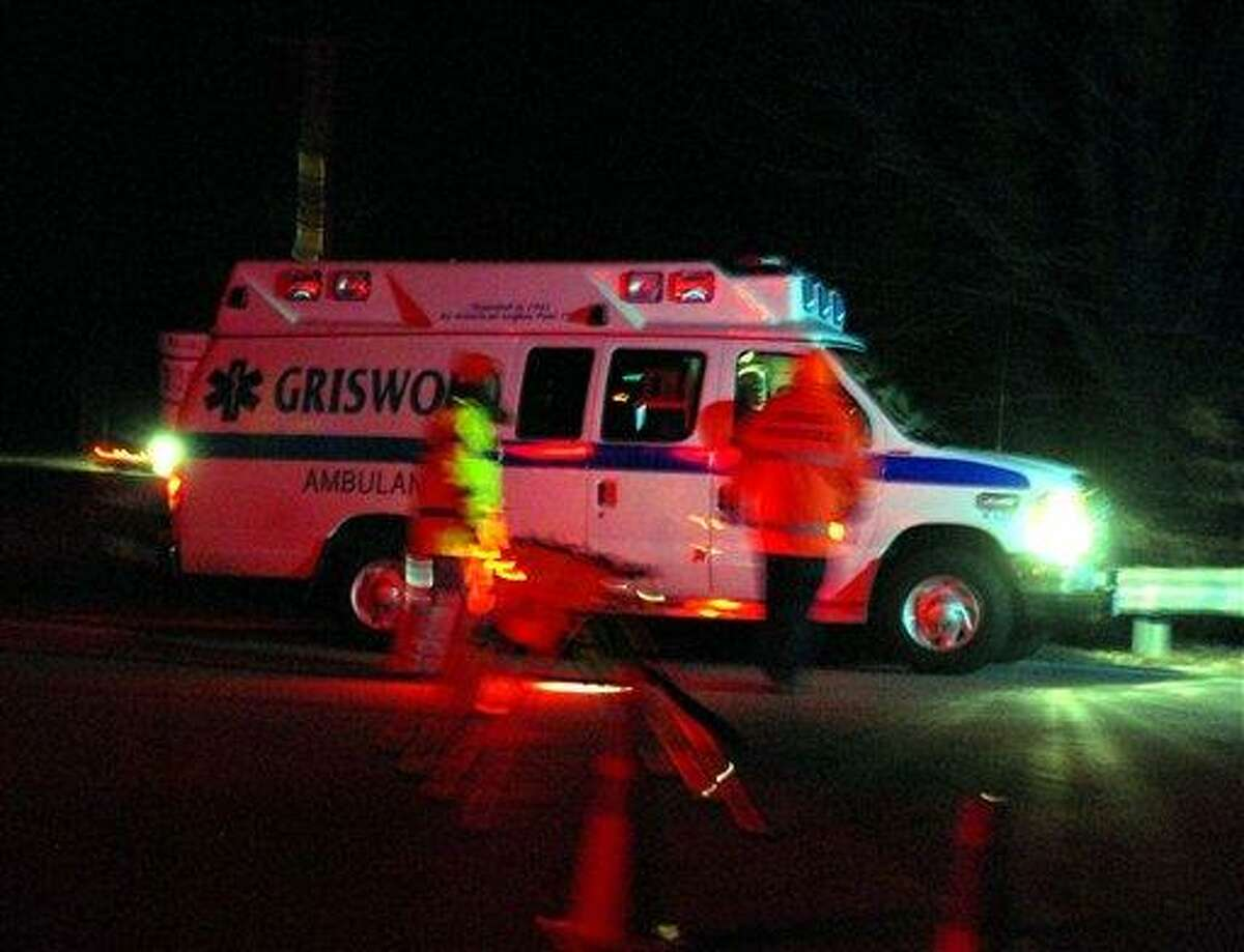 In this Tuesday, Dec. 7, 2010 photo, an ambulance arrives at the intersection of Routes 138 and 201 in Griswold, Conn. A teen driving on a tree-lined road in the area, lost control and crashed into a tree Tuesday, killing four high school students and seriously injuring another, authorities said. (AP Photo/Norwich Bulletin, Tali Greener) MANDATORY CREDIT; NO SALES.