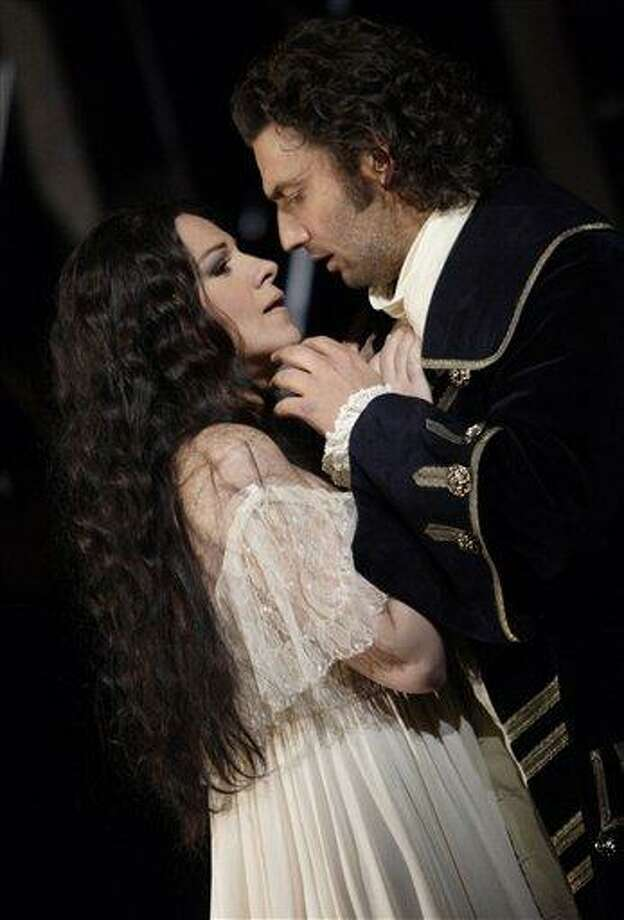 This image provided by The Royal Opera House, released Monday Nov. 22, 2010, shows Angela Gheorghiu as Adriana Lecouvreur and Jonas Kaufmann as Maurizio in the Royal Opera House production of Adriana Lecouvreur. (AP Photo/Catherine Ashmore/Royal Opera House) EDITORIAL USE ONLY Photo: AP / Royal Opera House
