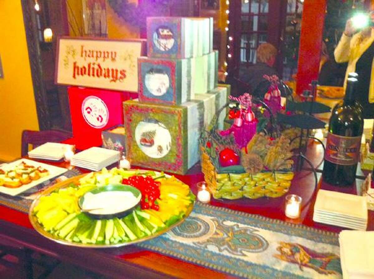 LINDSEY BURRILL/Register CitizenFood Assortment table at the Litchfield Saltwater Grille during their toy drive.