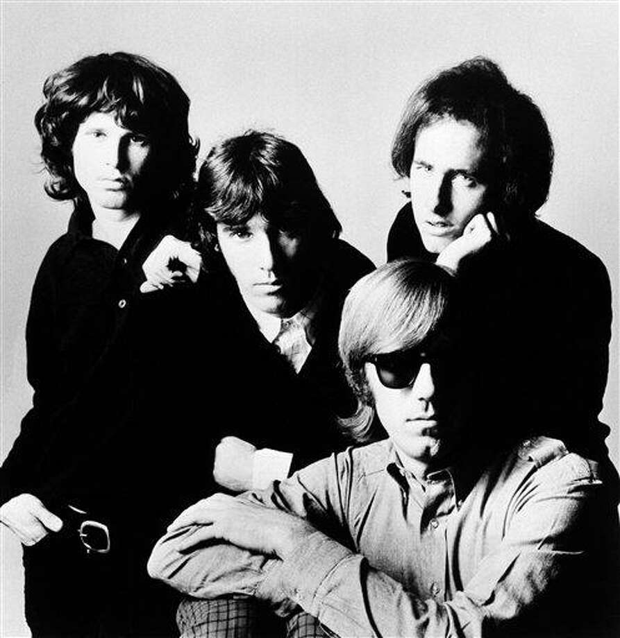 Members of The Doors, from left to right, Jim Morrison, John Densmore, Robby Krieger and Ray Manzarek in an undated photo.   Outgoing Florida Gov. Charlie Crist Crist told the St. Petersburg Times Tuesday  Nov. 16, 2010 he is looking to pardoning the long-dead rocker Jim Morrison who was convicted of exposing himself at a raucous 1969 concert in Miami. Photo: AP / 9999 AP