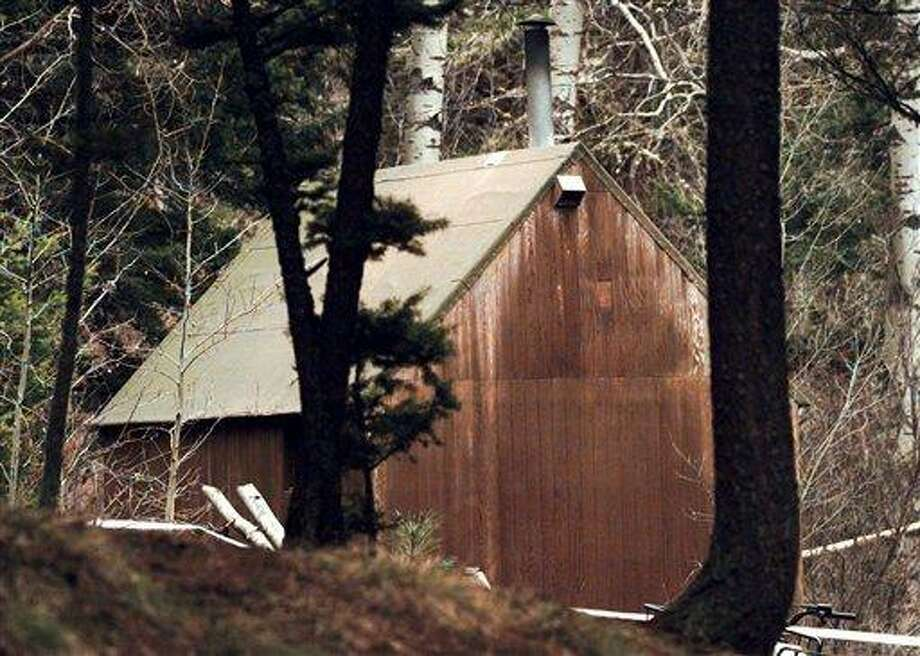 """FILE - In this April 6, 1996 file photo, Unabomber Theodore Kaczynski's cabin is shown in the woods of Lincoln, Mont. The 1.4-acre parcel of land in western Montana that was once owned by Kaczynski is on the market for $69,500. The listing offers potential buyers a chance to own a piece of """"infamous U.S. history"""" and says the forested land """"is obviously very secluded. (AP Photo/Elaine Thompson, File) Photo: AP / AP1996"""