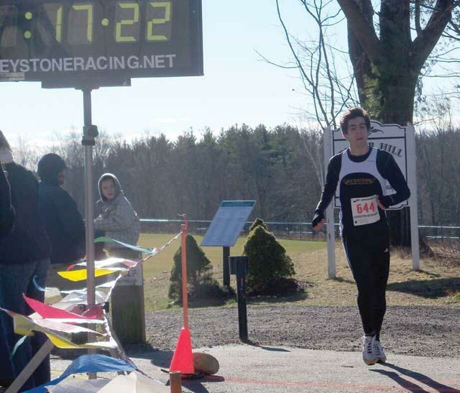 RICKY CAMPBELL/ Register CitizenTom Woermer,  17, is the first person to cross the finish line of the 28th Jingle Bell Run in Litchfield on Dec. 4.