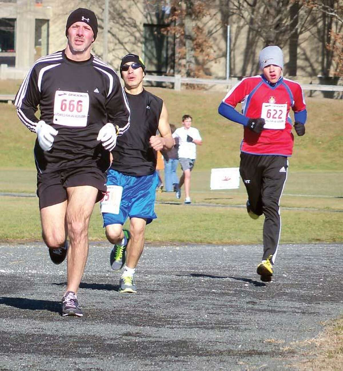 RICKY CAMPBELL/ Register CitizenRunners battling the cold and the wind at the 28th year of the Jingle Bell Run on Dec. 4.