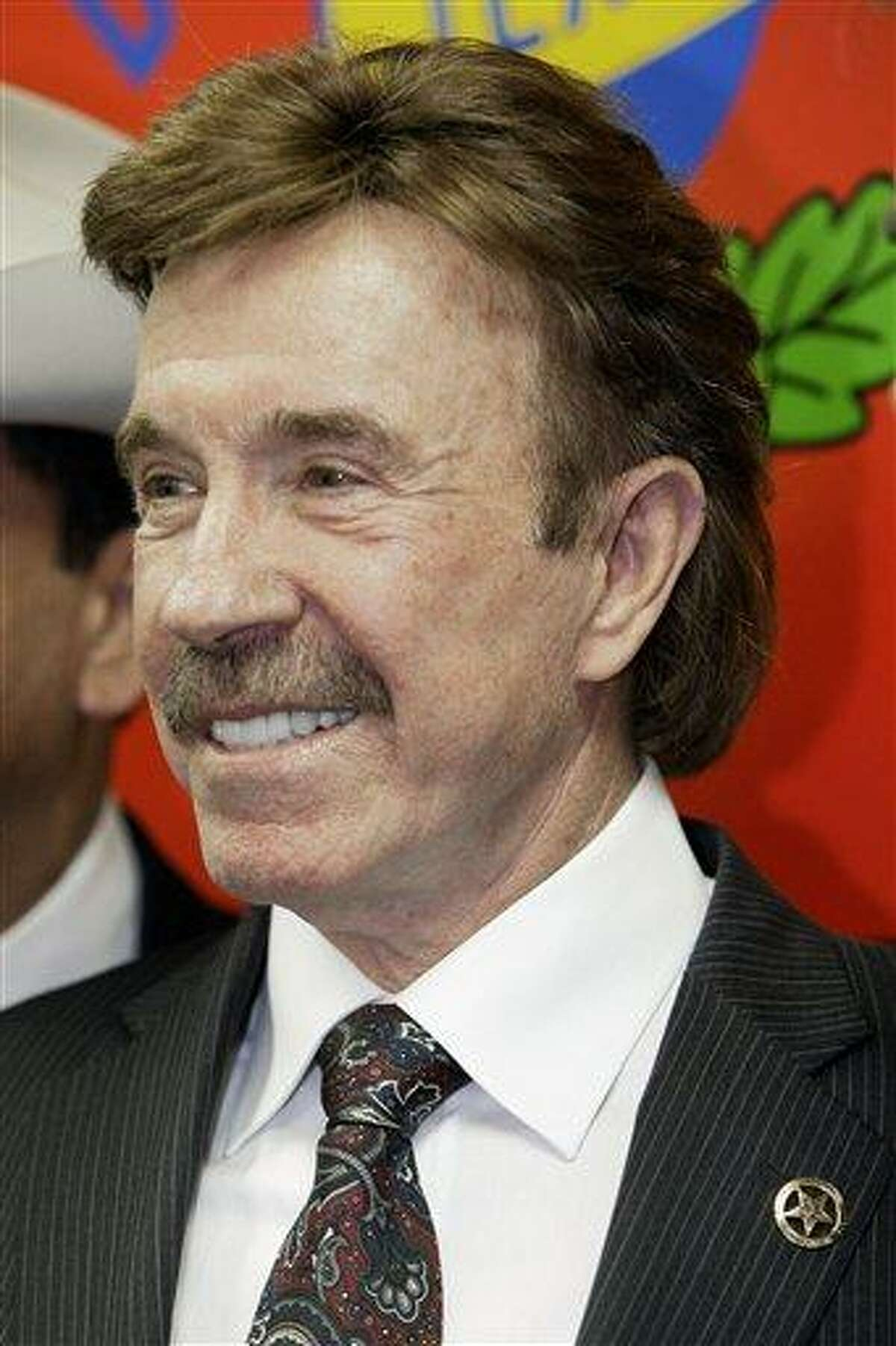Actor Chuck Norris wears a honorary Texas Rangers law enforcement pin during a ceremony Thursday, Dec. 2, 2010, in Garland, Texas. Martial-arts expert Norris became a real-life honorary Texas Ranger after having played a Ranger for years on television. (AP Photo/Tony Gutierrez)