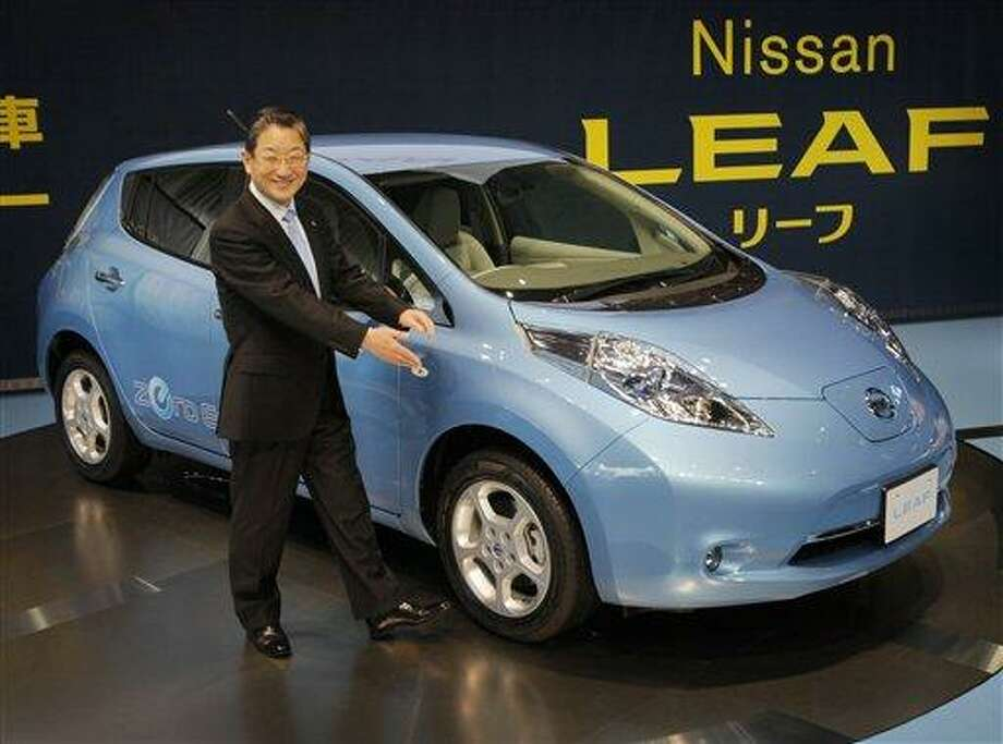 Nissan Motor Co. Chief Operating Officer Toshiyuki Shiga introduces the company's zero-emission electric car,  Leaf, during a news conference at its headquarters in Yokohama, Japan, Friday, Dec. 3, 2010. (AP Photo/Itsuo Inouye) Photo: AP / AP