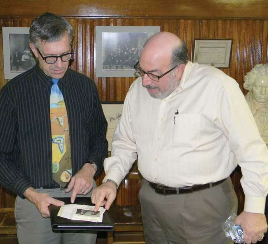 MIKE AGOGLIATI/ Register CitizenTorrington High School art teacher Victor Leger, left, was honored by the Probus Club of Torrington as the district's teacher of the year. Probus member Ed Arum presented Leger with a gift from the club.