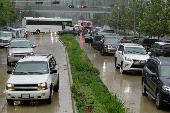 Traffic backs up around the George R. Brown Convention Center with Houstonians dropping off donations Monday, Aug. 28, 2017, in Houston.