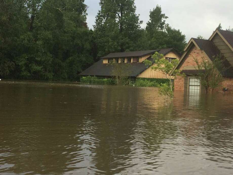 East Chambers boys basketball coach Todd Sutherland's house in Pinewood Estates, left, had taken on at least four feet of water as of Monday because of Hurricane Harvey. Sutherland and his family evacuated to Lake Charles on Sunday. Photo: Todd Sutherland/Facebook