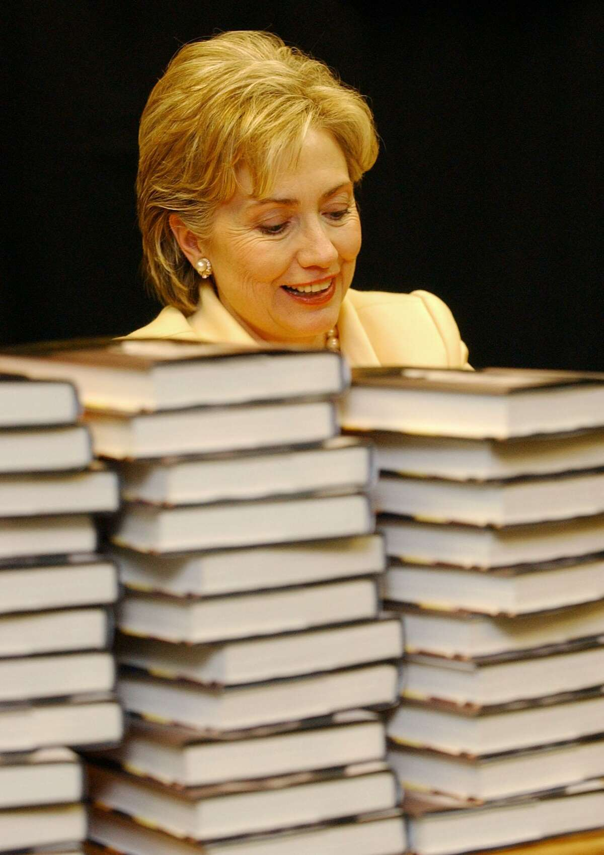 Sen. Hillary Rodham Clinton, D-N.Y., autographs copies of her new book,