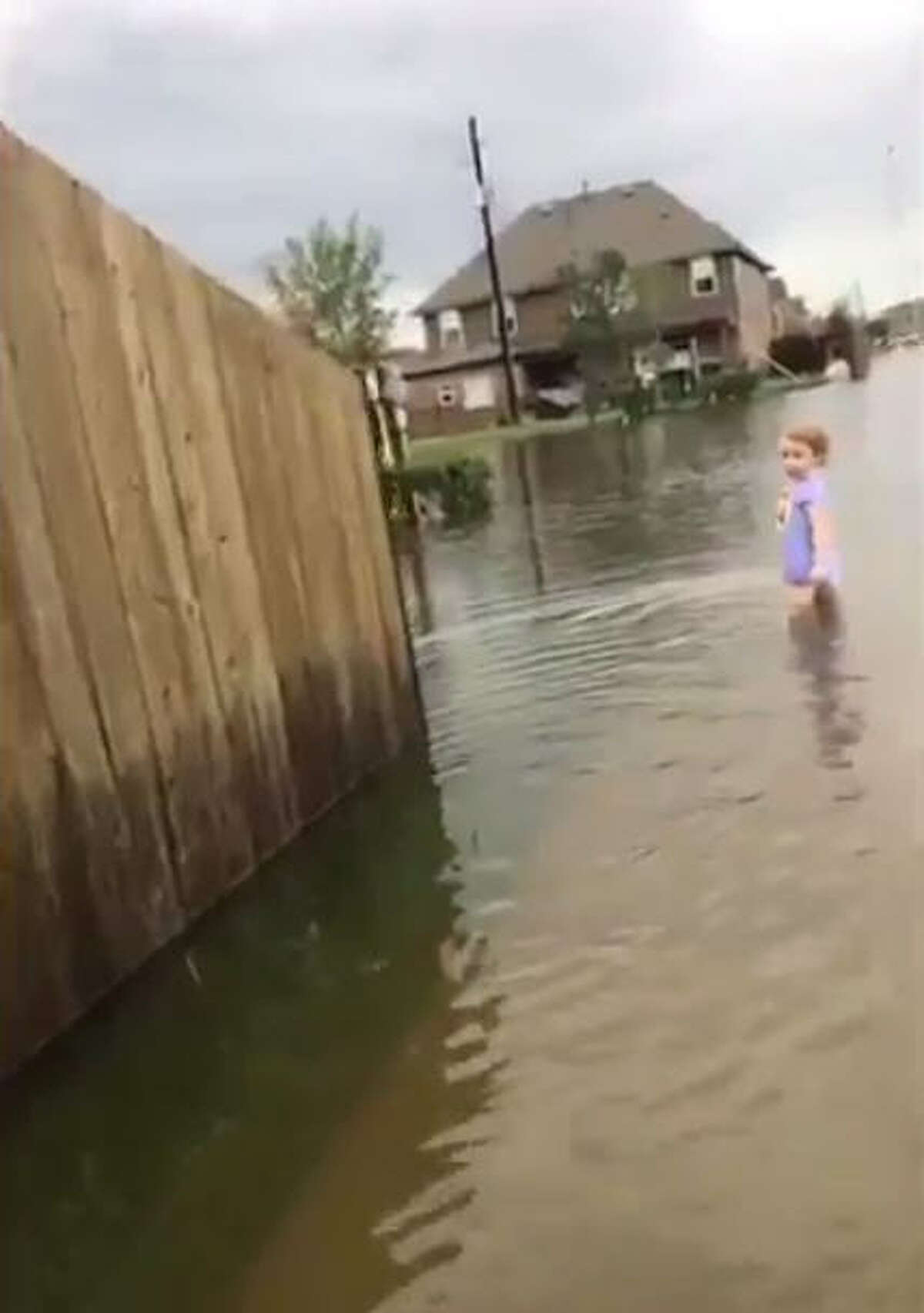 Videos taken by Pearland teen Renz Michael show a little girl in a diaper clutching her sippy cup wandering the flooded streets during Harvey. Keep going through the gallery to see other shocking photos of what the Houston area looks like during Harvey.Source: Twitter