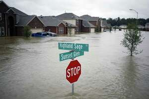 Houses at the Highland Glen subdivision stand in floodwaters due to Hurricane Harvey in Spring, Texas, U.S., on Monday, Aug. 28, 2017. A deluge of rain and rising floodwaters leftHoustonimmersed and helpless,crippling a global center of the oil industry and testing the economic resiliency of a state that's home to almost 1 in 12 U.S. workers. Photographer: Luke Sharrett/Bloomberg