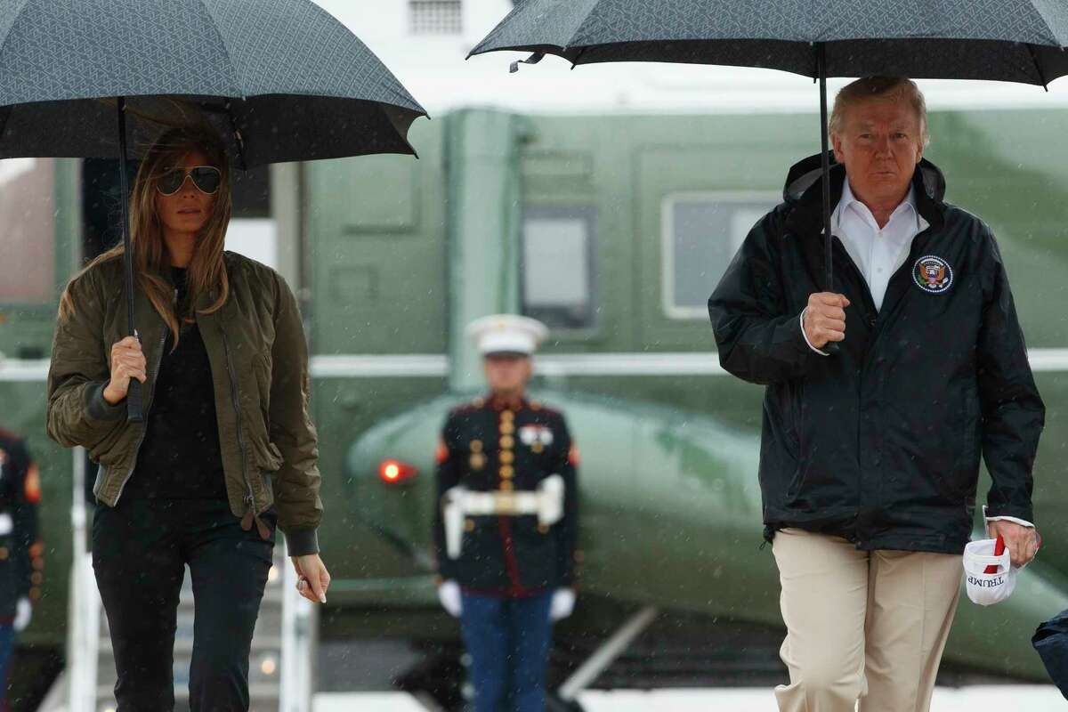 President Donald Trump and first lady Melania Trump walk from Marine One to board Air Force One at Andrews Air Force Base, Md., Tuesday, Aug. 29, 2017, for a trip to Texas to get an update on Harvey relief efforts.