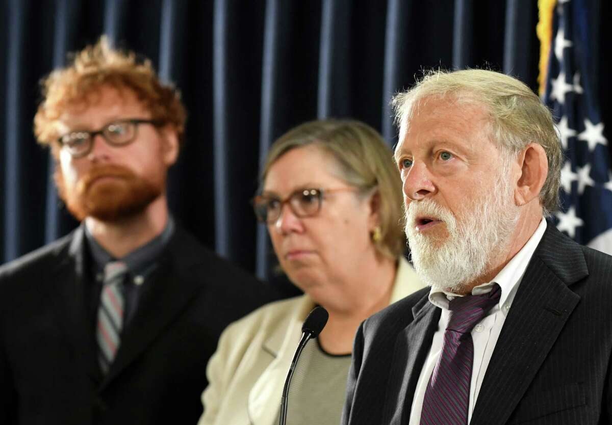Howard Freed, former director of the state Health Department's Center for Environmental Health, right, is joined by David Bond, associate director of the Center for the Advancement of Public Action at Bennington College, left, and Judith Enck, former U.S. Environmental Protection Agency regional administrator, center, during a press conference to announce a health survey covering three communities contaminated with toxic chemical PFOA on Tuesday morning, Aug. 29, 2017, at the Legislative Office Building in Albany, N.Y. (Will Waldron/Times Union)