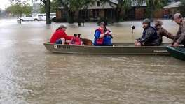 Cajun Navy members Chris and Aaron -- last names unknown -- rescued Stephanie Caro's family from Hurricane Harvey's floodwaters on Sunday morning.