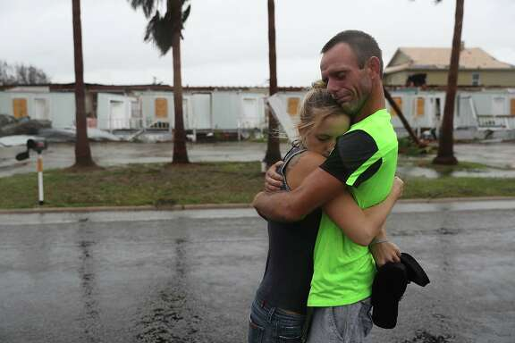 ROCKPORT, TX - AUGUST 26: Jessica Campbell hugs Jonathan Fitzgerald (L-R) after riding out Hurricane Harvey in an apartment on August 26, 2017 in Rockport, Texas.  Jessica said is became very scary once Hurricane Harvey hit their town. Harvey made landfall shortly after 11 p.m. Friday, just north of Port Aransas as a Category 4 storm and is being reported as the strongest hurricane to hit the United States since Wilma in 2005. Forecasts call for as much as 30 inches of rain to fall by next Wednesday.  (Photo by Joe Raedle/Getty Images)
