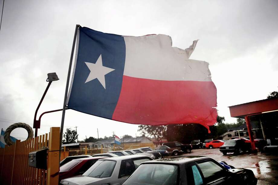 Wind from Hurricane Harvey batters a Texas flag on Aug. 26, 2017 in Houston. Fort Bend and Harris counties ranked among the top 15 on Allstate's list of stormiest Texas counties over the past 10 years.Scroll through to see the top 25 stormiest counties since 2008. Photo: Scott Olson/Getty Images