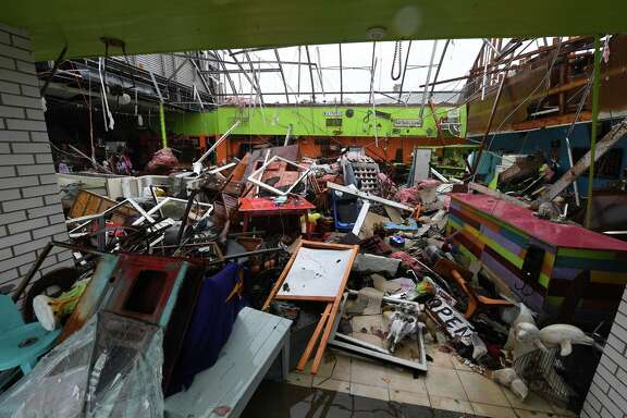 Damage to a store after Hurricane Harvey hit Rockport, Texas on August 26, 2017. / AFP PHOTO / MARK RALSTON        (Photo credit should read MARK RALSTON/AFP/Getty Images)