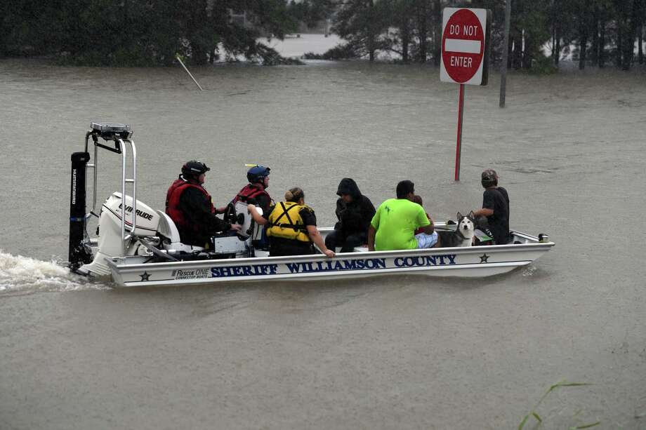 Williamson County Sheriff Dept. from the Austin areawere among over 144 organizations across Texas that came to Houston in support. Photo: MARK RALSTON/AFP/Getty Images