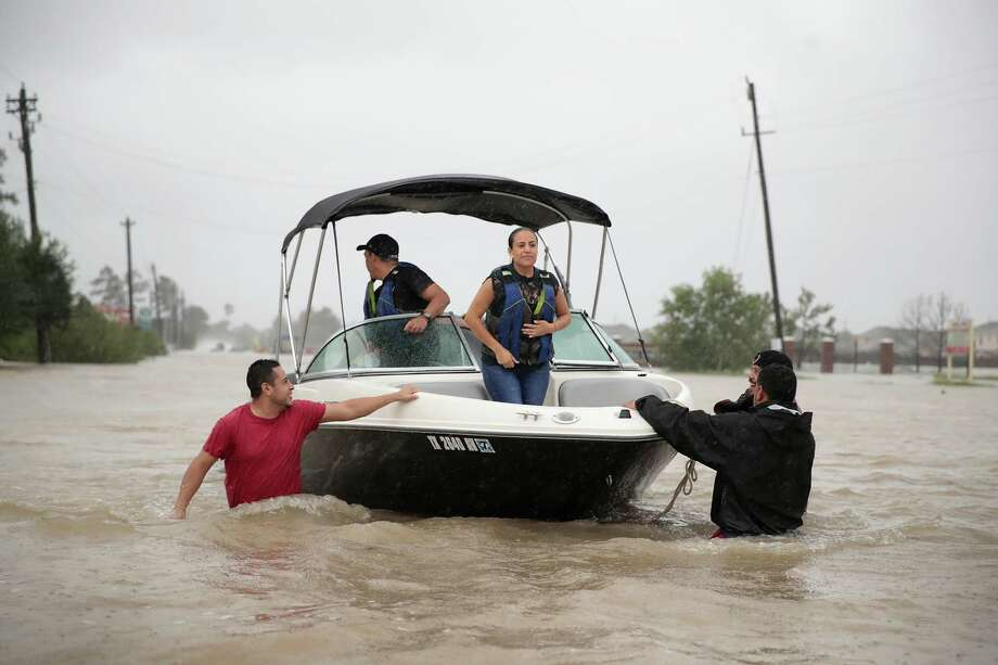 People are rescued from a flooded neighborhood after it was inundated with rain water, remnants of Hurricane Harvey, on August 28, 2017 in Houston, Texas. Photo: Scott Olson/Getty Images