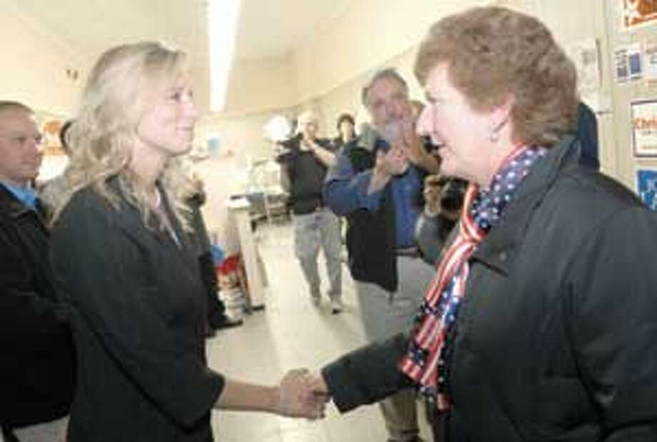 State Rep. Anne Ruwet, right, concedes the race to Michelle Cook Tuesday night. (Mic Nicosia photo)