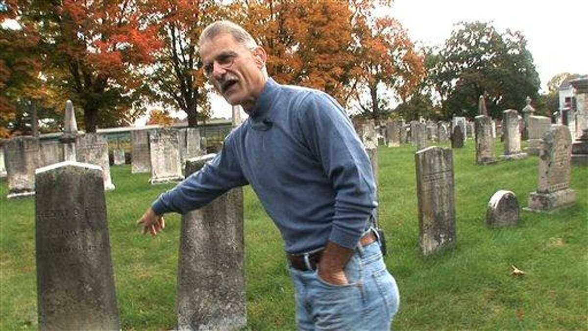 Connecticut State Archeologist Nick Bellantoni visits the headstones of the Ray family in the Jewett City Cemetery in Griswold, Conn., on Tuesday, October 14, 2008. The Ray family were part of what has come to be known as the New England Vampire belief and centers around the mid 19th century deaths by tuberculosis of a number of families in the area (AP Photo/The Day, Peter Huoppi)