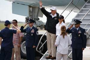 President Donald Trump and first lady Melania Trump arrive on Air Force One at Corpus Christi International Airport in Corpus Christi, Texas, Tuesday, Aug. 29, 2017, for briefings on Hurricane Harvey relief efforts. (AP Photo/Evan Vucci)