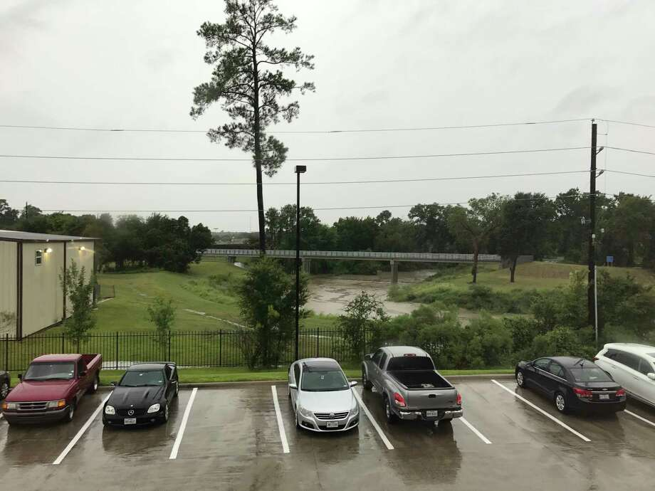 On Friday, we could see the creek, a footbridge and plenty of trees from our window. A couple of days later, it was all a river. Photo: Alyson Ward