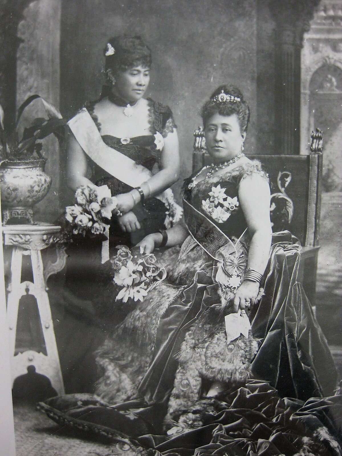 Queen Kapiolani (seated) and her sister-in-law, who later became Queen Liliuokalani, attended the golden jubilee of Queen Victoria in Hawaiian-inspired gowns that have now been reproduced.