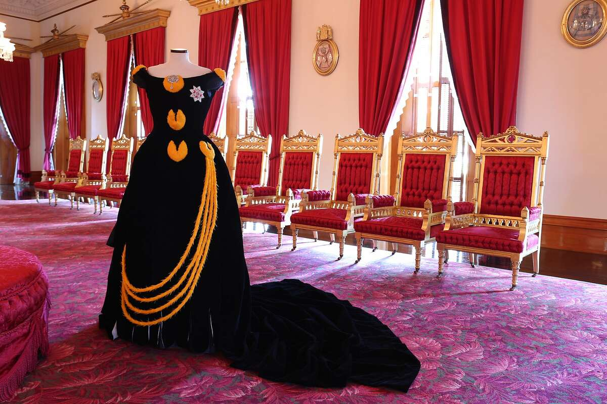 Modern featherwork artisans in Hilo helped re-create Queen Kapiolani�s lei hulu (feather lei) gown, seen here in Iolani Palace�s Throne Room.
