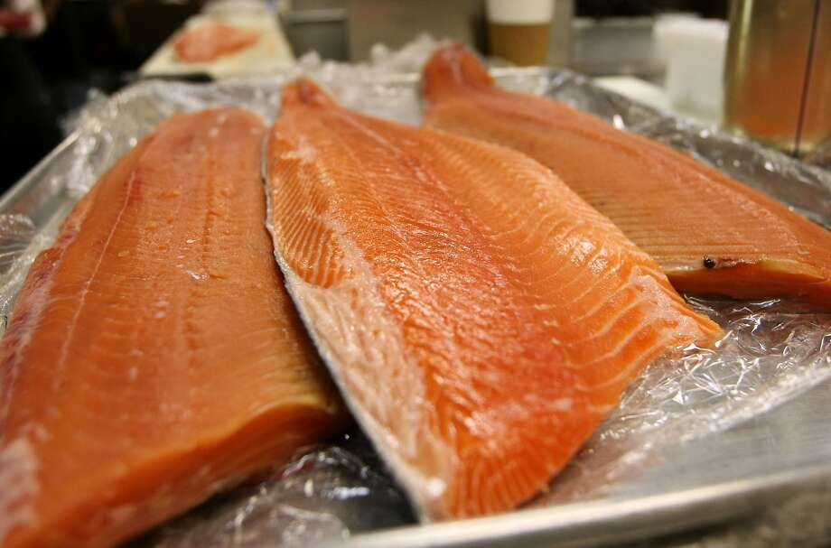 SAN FRANCISCO - Fresh wild and farmed Loch Duart salmon filets are seen on a tray at the San Francisco Fish Company April 11, 2008 in San Francisco, California. (Photo by Justin Sullivan/Getty Images) Photo: Justin Sullivan, Getty Images