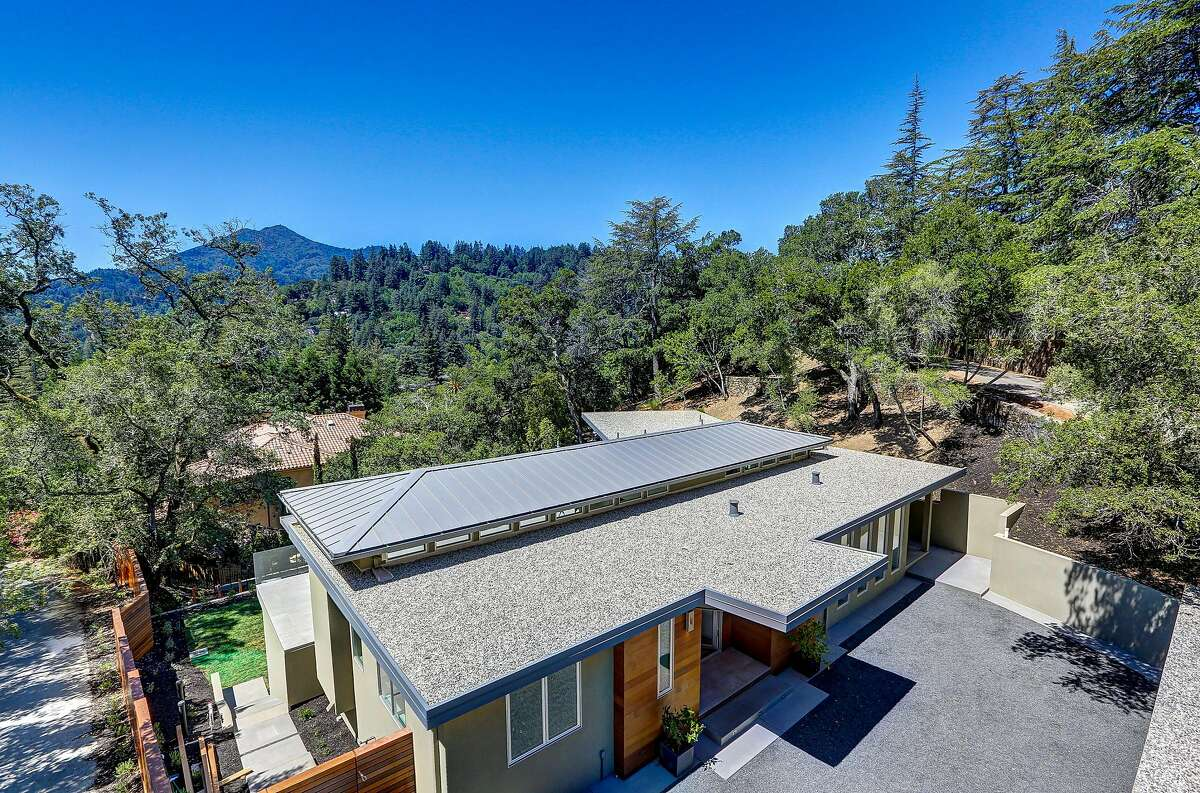 The cascading hillside home sits on more than half an acre.