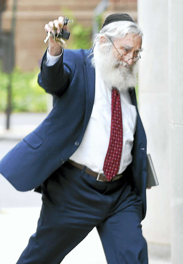 Rabbi Daniel Greer is photographed leaving Superior Court in New Haven Tuesday after not guilty pleas were entered to charges of second-degree sexual assault and risk of injury to a minor. Photo: Arnold Gold / Hearst Connecticut Media / New Haven Register