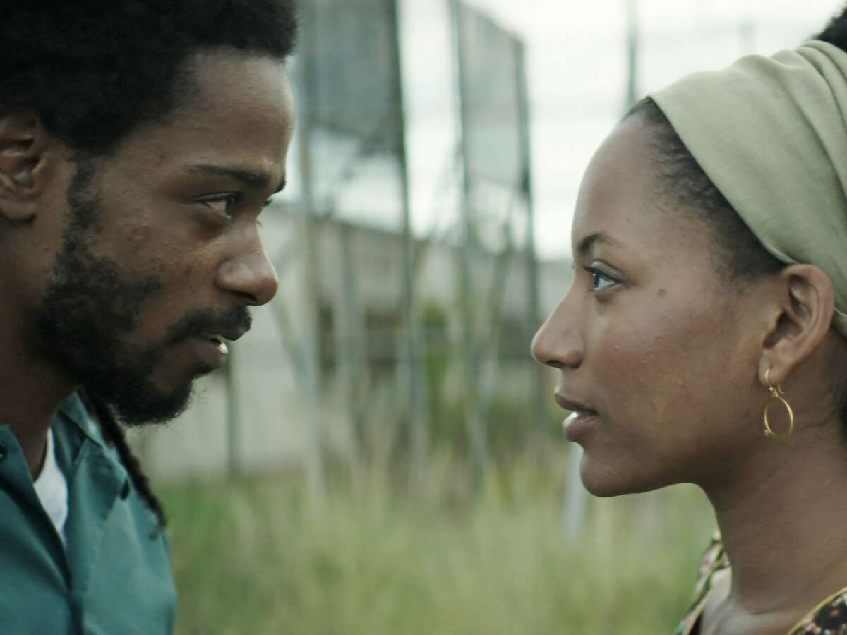 This image released by IFC Films shows Lakeith Stanfield, left, and Natalie Paulin