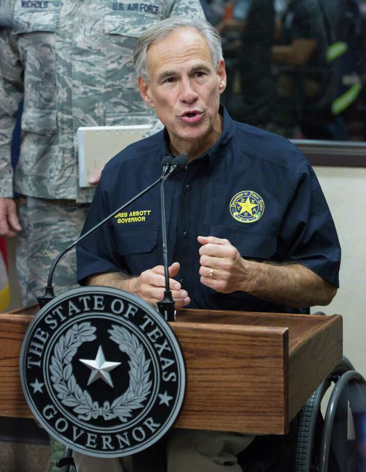 File: Texas Gov. Greg Abbott gives a briefing at the State of Texas Emergency Command Center at DPS headquarters in Austin as they monitor Hurricane Harvey Sunday afternoon. (Suzanne Cordeiro / AFP/Getty Images) Photo: SUZANNE CORDEIRO, Contributor / AFP or licensors